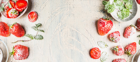 powdered sugar: Sweet strawberries  with  powdered sugar  and mint leaves  on white shabby chic wooden background, top view, banner