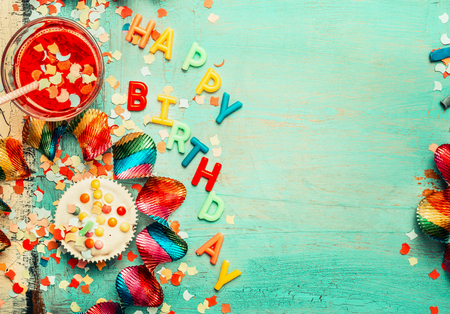 birthday decoration: Happy birthday background with lettering, red decoration, cake and drinks , top view, place for text. Festive greeting or invitation card