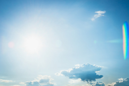 Beautiful blue summer sky with sun and small clouds. Sky Nature background