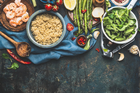 green vegetable: Cooked white quinoa in bowl with fresh vegetables cooking ingredients on dark rustic background, top view, border. Superfood , healthy eating or vegetarian food concept.