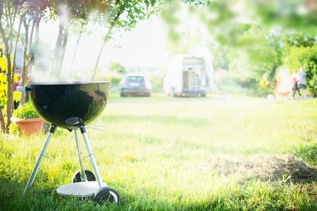 Grill with smoke over summer  outdoor nature in garden or park, outdoor, close up Banque d'images