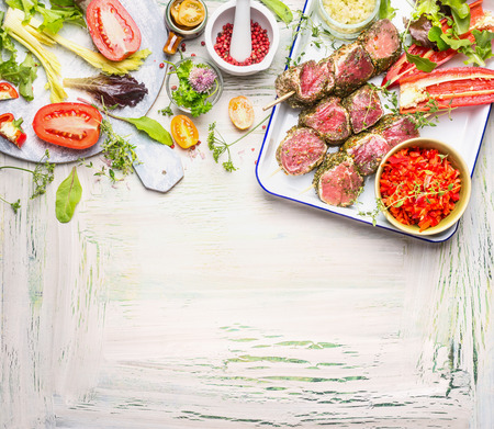 meat grill: Meat skewers with fresh herbs, spices and vegetables ingredients for grill or cooking. Preparation on light wooden background, top view, border Stock Photo
