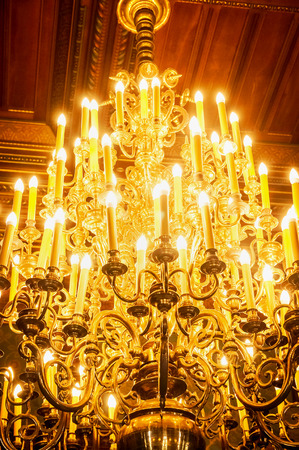 ambient: Old Chrystal chandeliers with ambient light, close up Stock Photo