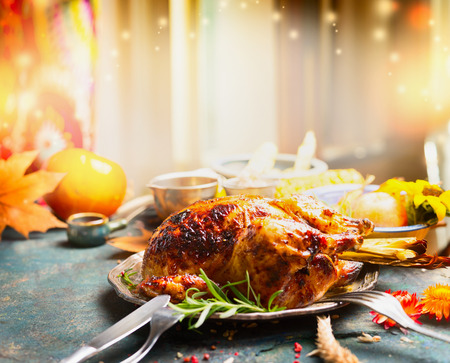 traditional christmas dinner: Thanksgiving Day dinner table with roasted  turkey, side view