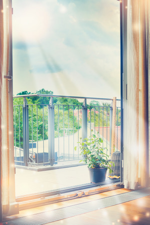 Suns rays shine into the room through an open window