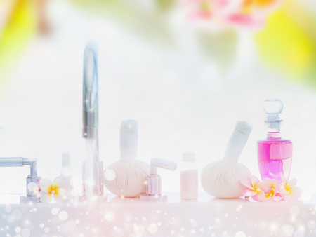 aroma: Light spa or wellness background with Bathtub , body care products, massage stamps and frangipani flowers
