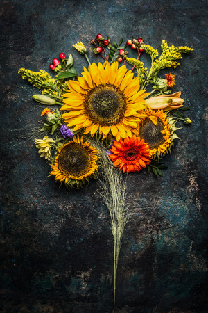 bunch of flowers: Autumn flowers bunch with sunflowers on dark vintage background, top view