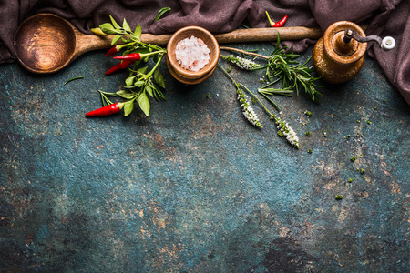 kitchen counter top: Rustic Cooking background with wooden spoon,fresh herbs and spices, top view