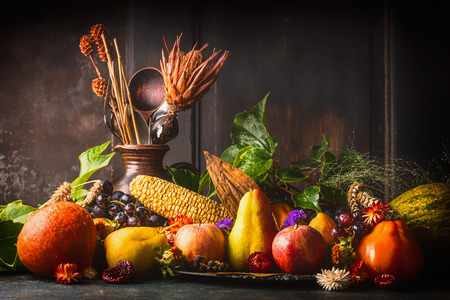 rustic kitchen: Various fall fruits and vegetables on dark rustic kitchen table at wooden background, side view,copy space. Autumn harvest concept.