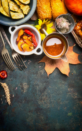 autumn food: Autumn food with roasted vegetables and sauce, top view, copy space