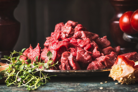 side of beef: Raw Beef goulash  of young bulls , chopped meat, close up, side view