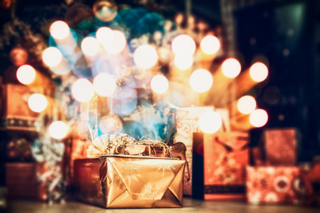 home lighting: Christmas background , home scene with holiday gifts and festive bokeh lighting