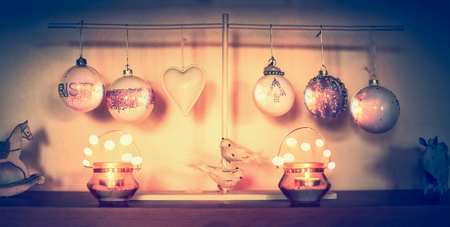 bokeh lights: Christmas home decoration on tables with balls, candles and holiday bokeh Stock Photo