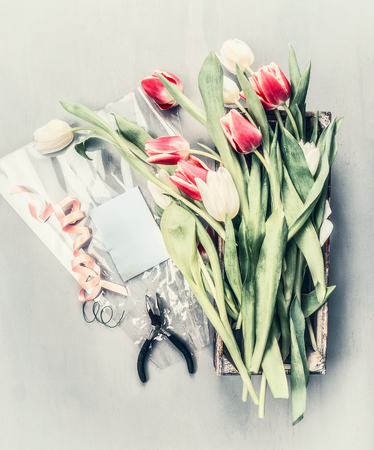 bunch of flowers: Bunch of tulips making with florist tools, top view