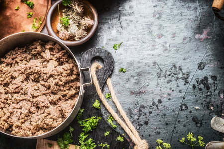 ground: Cooking pot with frying ground beef on dark rustic kitchen table , top view,  place for text Stock Photo