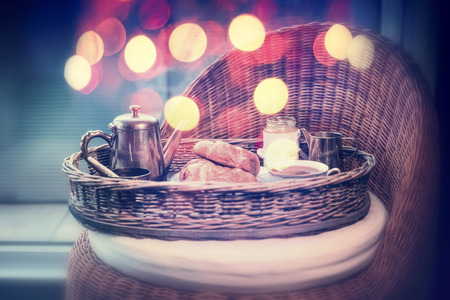 Weekend or holiday breakfast with vintage coffee pot and croissants, mug of coffee and bokeh