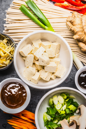 doufu: Asian food ingredients: tofu, noodles, ginger, cut vegetables, Sprout,green onion and hoisin sauce for tasty cooking, top view