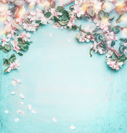 Beautiful spring nature background with lovely blossom, petal and bokeh on turquoise blue background , top view, frame. Springtime concept Фото со стока - 70172093