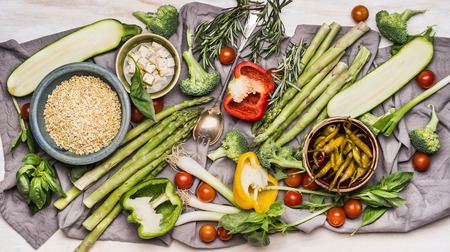 Various ingredients for tasty vegetarian cooking with organic vegetables, pearl barley and feta cheese, top view. Healthy clean food or diet nutrition concept
