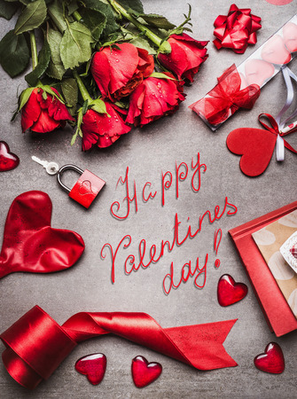 over white: Valentines day greeting card with love symbols , red decoration and beautiful roses bunch, and handwritten lettering Happy Valentines day, top view, frame