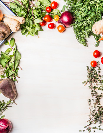 Fresh organic vegetables food background on white wooden , top view, frame Archivio Fotografico