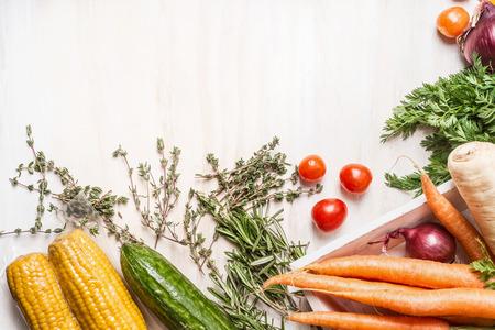 vegetables on white: Various fresh organic vegetables on white wooden background, top view, border Stock Photo