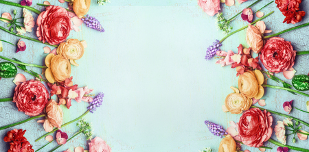 Pretty floral banner with various colorful garden flowers on blue turquoise shabby chic background, top view