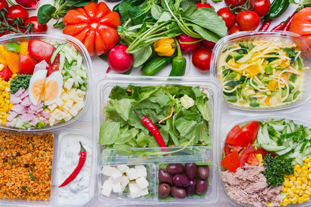 Various healthy salad in plastic packages for diet lunch, top view. Clean organic  food concept Stock Photo - 77709144