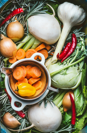 Various organic seasonal regional vegetables ingredients, fresh condiment and root vegetables for Healthy , clean food or vegetarian, vegan cooking and eating concept Фото со стока