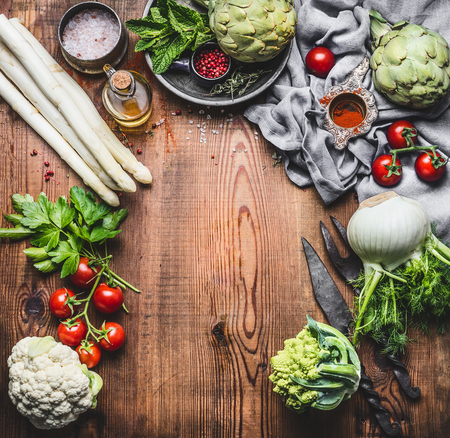 Vegetarian cooking concept with asparagus and Others organic harvest vegetables and ingredients on wooden rustic background, top view, frame
