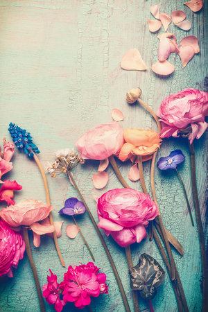 Pretty flowers retro pastel toned on vintage turquoise background, top view Stock Photo