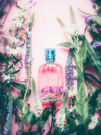 Foral Perfume bottle with plants and flowers, top view. Perfumery, cosmetics, botanical fragrance concept. Reklamní fotografie