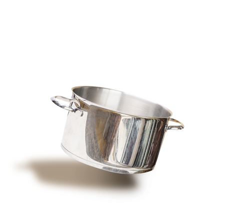 Flying empty cooking pot , isolated on white background, front view Stock Photo