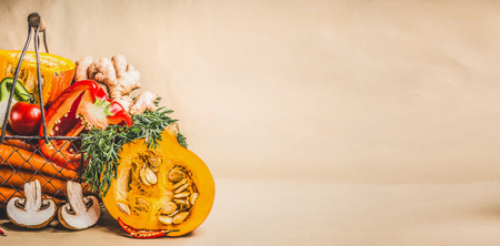 Pumpkin and organic seasonal vegetables for vegetarian and healthy cooking, front view, banner