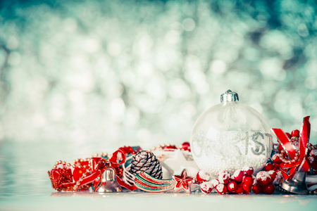 Christmas background with glass balls and red festive decoration at winter bokeh background, front view Stock Photo