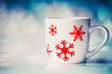 Cup with snowflakes on winter bokeh background, front view Stock Photo - 85080271
