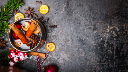 Mug with mulled wine and Christmas decoration on dark background, top view, place for text Stock Photo