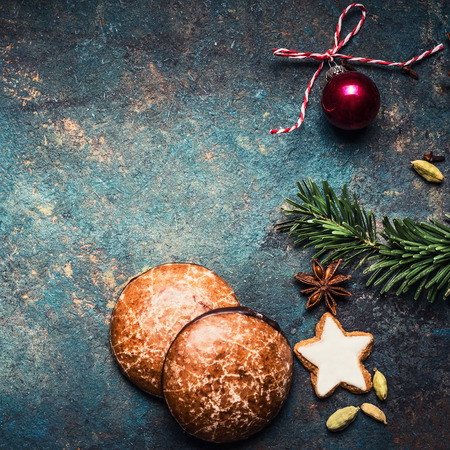 Christmas background with Gingerbread , star cookies and decoration on dark rustic background, top view, square