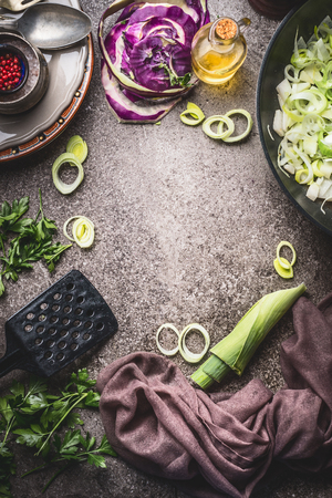 Cooking  food background with kohlrabi , leeks , frying pan and kitchen tools, top view. Healthy vegetarian food and eating, clean or diet nutrition concept