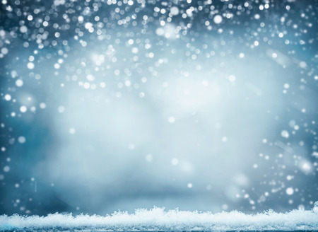 Blue winter background with snow. Winter holidays and Christmas concept Stock Photo