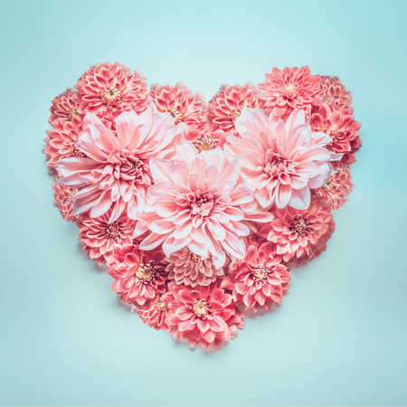 Pastel color heart made of lovely pink flowers on turquoise blue pastel color heart made of lovely pink flowers on turquoise blue background top view mightylinksfo