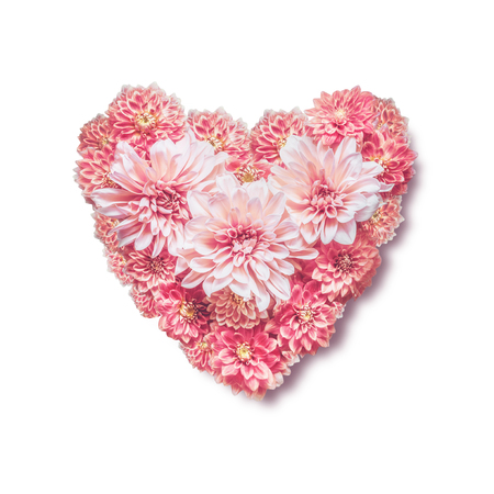 Heart made with pink flowers, isolated on white background, top view. Love, wedding or valentines day concept. Layout for greeting card Stock Photo