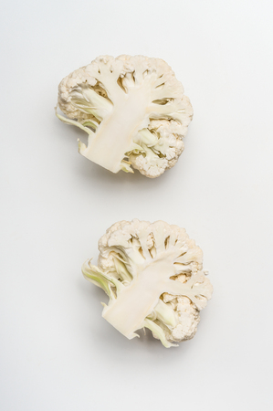 Close up of cabbage cauliflower head on white background, top view