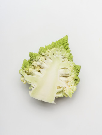 Close up of half head of Romanesco  broccoli cabbage on white background, top view