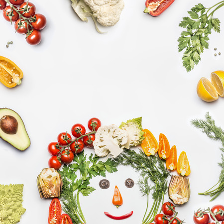 Healthy lifestyle concept. Various fresh vegetables with ingredients on white background, top view, frame. Layout for detox, dieting and clean eating food