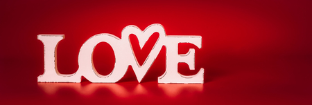 White Word Love on red background, front view. Valentines day concept Stock Photo