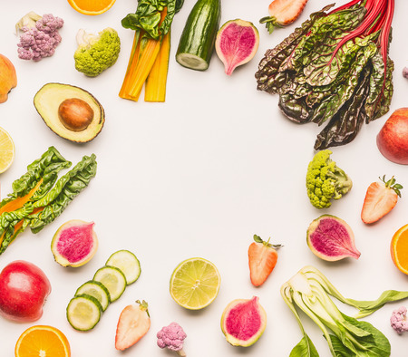 Various healthy fruits and vegetables ingredients frame on white desk background, top view, flat lay. Healthy clean and detox, weight loss dieting or fasting  food concept 스톡 콘텐츠