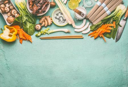 Asian food background with tasty ingredients: Mu Err Mushrooms , various vegetables , pok choi , coconut milk, lemongrass and noodles , top view, copy space. Vegetarian or vegan asian cuisine