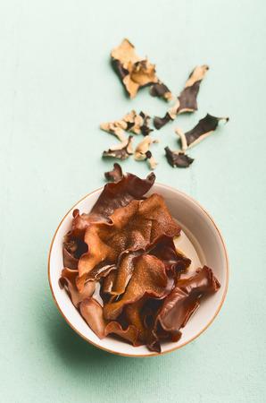 Chinese Mu Err Mushrooms in bowl , close up. Auricularia judae Stock Photo