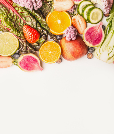 Variety of fresh colorful fruits and vegetables on white background, top view, border. Healthy food and clean eating concept